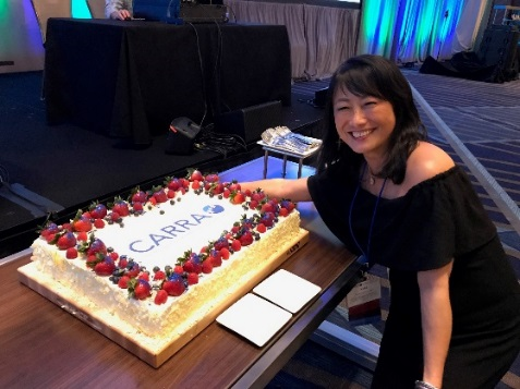 CARRA President, Yuki Kimura, getting ready to cut the CARRA anniversary cake